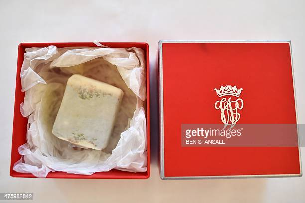 A boxed slice of wedding cake from the British Royal wedding of Prince William Duke of Cambridge to Britain's Catherine Duchess of Cambridge...