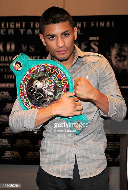 Boxer Abner Mares poses with the WBC belt after the bantamweight tournament final press conference at the Hard Rock Hotel and Casino on July 14 2011...