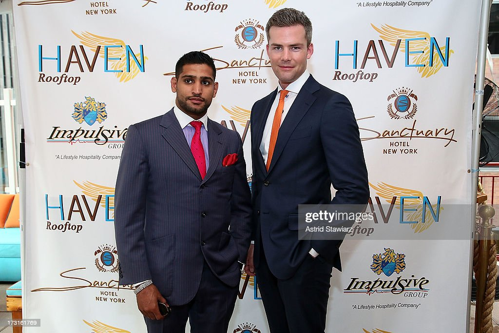 Boxer <a gi-track='captionPersonalityLinkClicked' href=/galleries/search?phrase=Amir+Khan+-+Boxeur&family=editorial&specificpeople=162795 ng-click='$event.stopPropagation()'>Amir Khan</a> and TV Personality Ryan Serhant attend <a gi-track='captionPersonalityLinkClicked' href=/galleries/search?phrase=Amir+Khan+-+Boxeur&family=editorial&specificpeople=162795 ng-click='$event.stopPropagation()'>Amir Khan</a> & Faryal Makhdoom's Welcome To New York Party at Haven Rooftop at Sanctuary Hotel on July 8, 2013 in New York City.