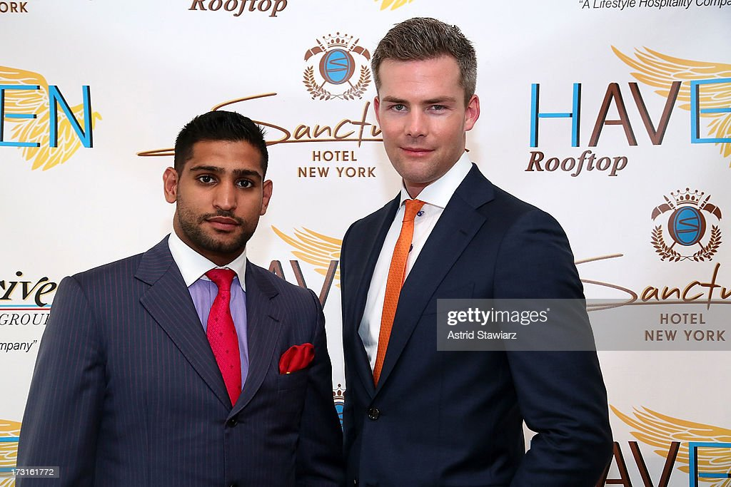 Boxer <a gi-track='captionPersonalityLinkClicked' href=/galleries/search?phrase=Amir+Khan+-+Boxer&family=editorial&specificpeople=162795 ng-click='$event.stopPropagation()'>Amir Khan</a> and TV Personality Ryan Serhant attend <a gi-track='captionPersonalityLinkClicked' href=/galleries/search?phrase=Amir+Khan+-+Boxer&family=editorial&specificpeople=162795 ng-click='$event.stopPropagation()'>Amir Khan</a> & Faryal Makhdoom's Welcome To New York Party at Haven Rooftop at Sanctuary Hotel on July 8, 2013 in New York City.