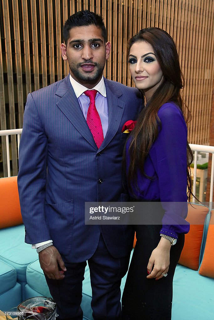 Boxer <a gi-track='captionPersonalityLinkClicked' href=/galleries/search?phrase=Amir+Khan+-+Boxare&family=editorial&specificpeople=162795 ng-click='$event.stopPropagation()'>Amir Khan</a> and wife Faryal Makhdoom attend their Welcome To New York Party at Haven Rooftop at Sanctuary Hotel on July 8, 2013 in New York City.