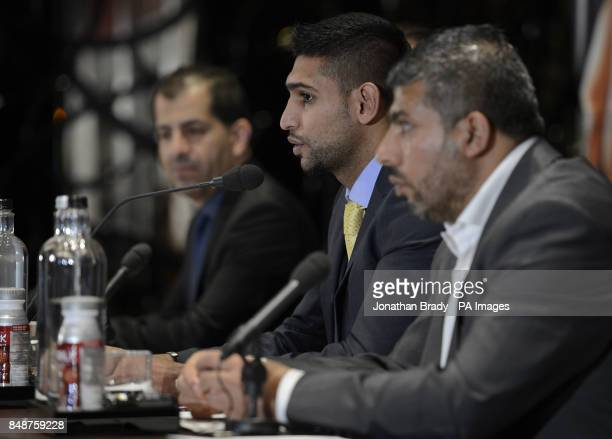 Boxer Amir Khan attends a press conference alongside his manager Asif Vali and Showtime's Stephen Espinoza at The Mayfair Hotel London