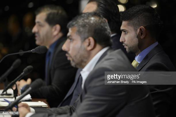 Boxer Amir Khan attends a press conference alongside his manager Asif Vali and Showtime's Stephen Espinoza during the press conference at The Mayfair...