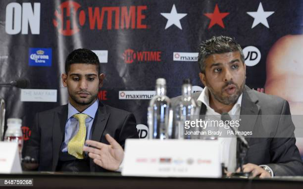 Boxer Amir Khan attends a press conference alongside his manager Asif Vali during the press conference at The Mayfair Hotel London