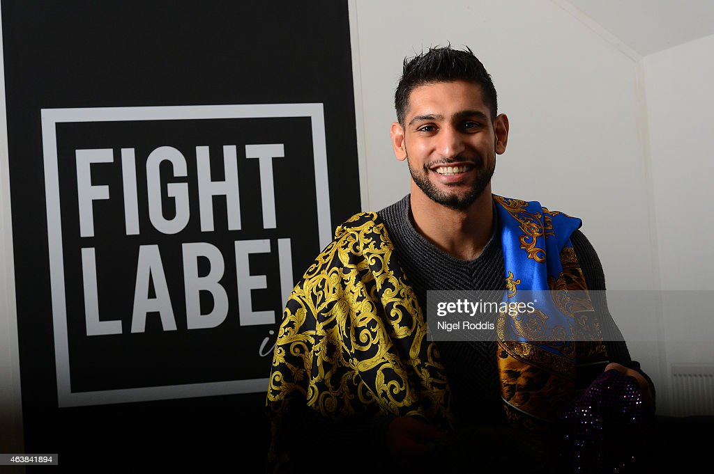Boxer Amir Khan poses for a photograph during a visit to Fight Label who make his shorts on February 19 2015 in Sheffield England