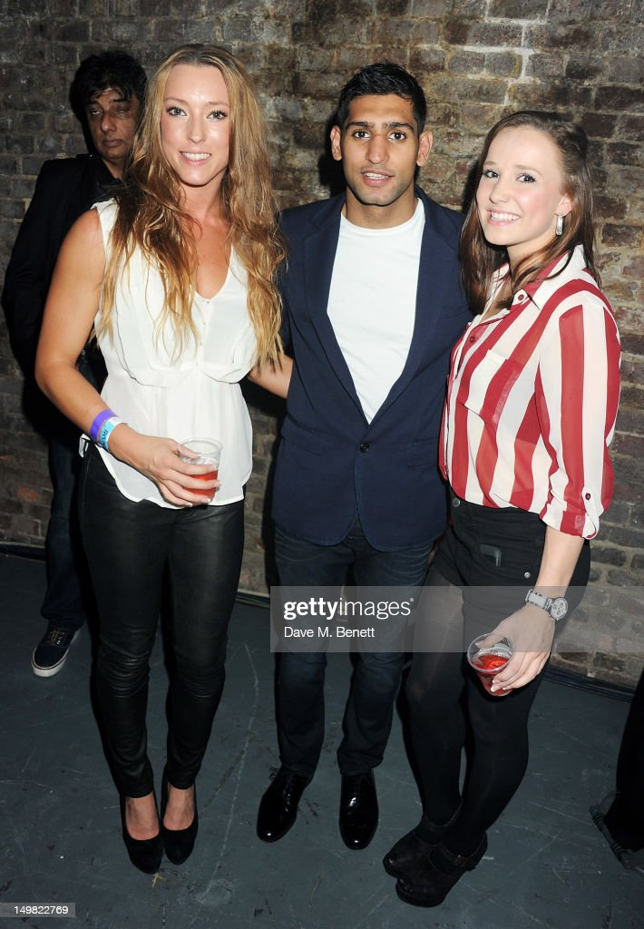Boxer <a gi-track='captionPersonalityLinkClicked' href=/galleries/search?phrase=Amir+Khan+-+Boxer&family=editorial&specificpeople=162795 ng-click='$event.stopPropagation()'>Amir Khan</a> (C) poses with Great Britain Olympic Gymnasts Imogen Cairns (R) and Hannah Whelan attend a VIP Reception as Glaceau vitaminwater presents 'Jessie J Live In London' at The Roundhouse on August 4, 2012 in London, England.