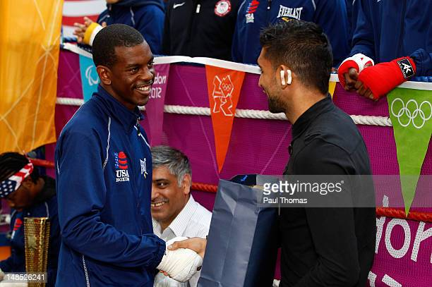 Boxer Amir Khan shakes hands with Jamel Herring of the USA after being presented a gift from the USA Olympic Boxing team during the Amir Khan USA...