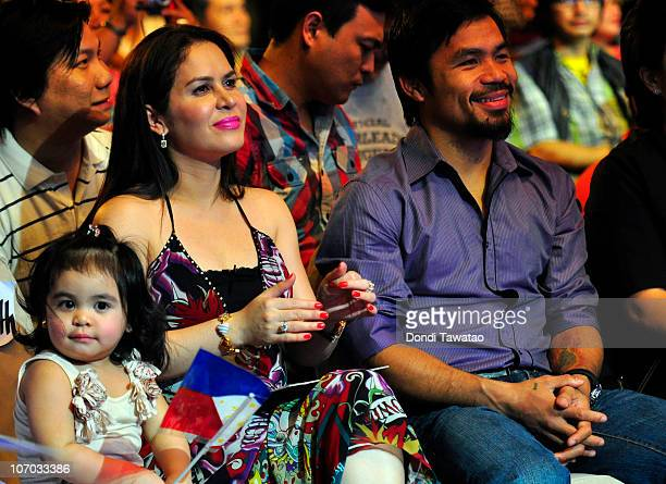 Boxer and congressman Manny Pacquiao attends his concert in Manila with wife Jinky and youngest daughter Qeen Elizabeth following his win of the WBC...