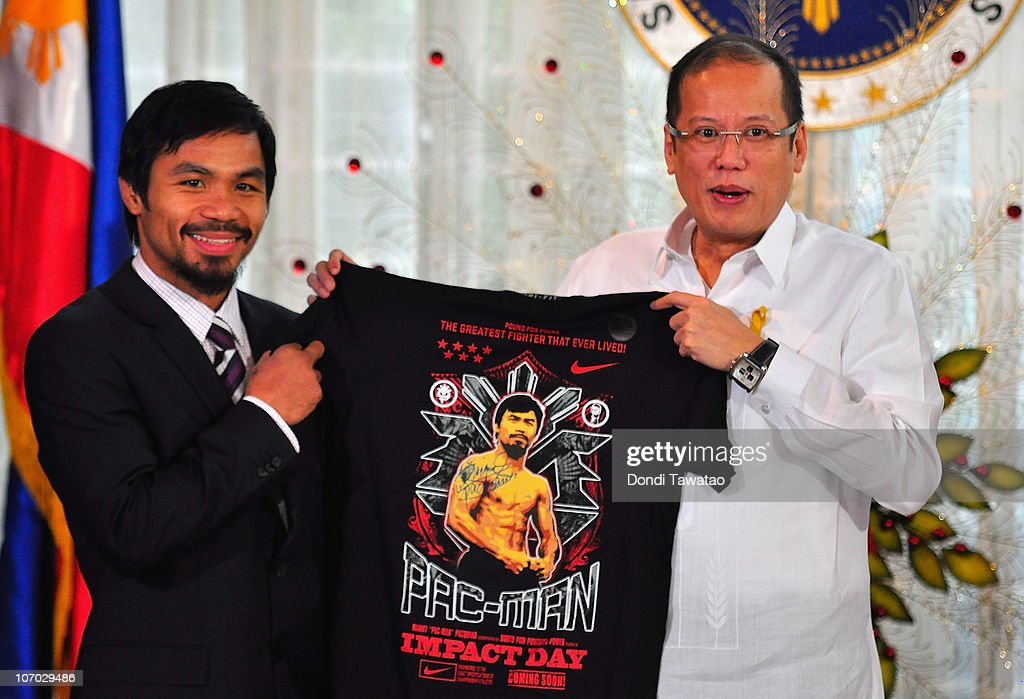 Boxer and congressman, <a gi-track='captionPersonalityLinkClicked' href=/galleries/search?phrase=Manny+Pacquiao&family=editorial&specificpeople=3855506 ng-click='$event.stopPropagation()'>Manny Pacquiao</a> gives President <a gi-track='captionPersonalityLinkClicked' href=/galleries/search?phrase=Benigno+Aquino+III&family=editorial&specificpeople=3760869 ng-click='$event.stopPropagation()'>Benigno Aquino III</a> a shirt and memorabilia following his win of the WBC super welterweight crown against Mexican Antonio Margarito on November 20, 2010 in Manila, Philippines. Pacquiao, an icon in the Philippines, won his eigth world title against Mexican Antonio Margarito last week. Pacquiao is regarded as a hero in the country and is the first boxer to be elected to the House Representatives in the Philippines.