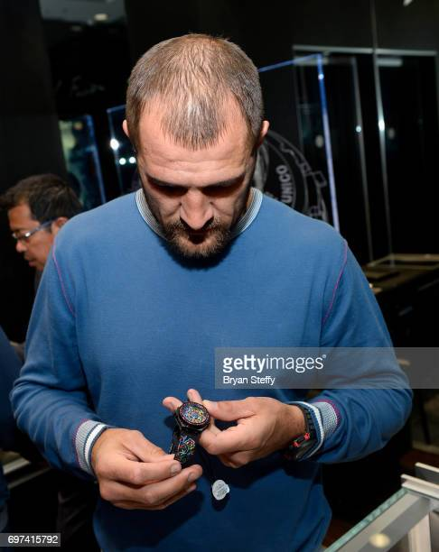 Boxer and Hublot ambassador Sergey Kovalev examines the Hublot Big Bang Broderie Sugar Skull watch during his visit to the Hublot Boutique at The...