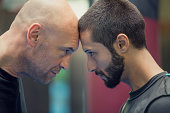 Boxer and sparring partner face to face portrait