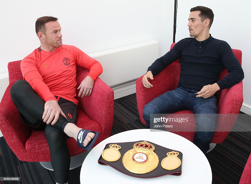 Boxer Anthony Crolla chats to Wayne Rooney of Manchester United during a Manchester United training session at Aon Training Complex on September 14, 2016 in Manchester, England.