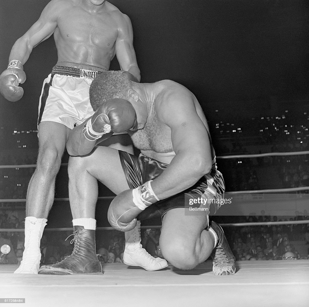 Boxer <a gi-track='captionPersonalityLinkClicked' href=/galleries/search?phrase=Archie+Moore&family=editorial&specificpeople=93092 ng-click='$event.stopPropagation()'>Archie Moore</a> waits for the count with his head in his hands in the fourth round of a fight with Cassius Clay in 1962. Clay hit Moore twice within seconds for counts of 8 and 6, then hit him with a right to the head that ended the fight without a count as referee Tommy Hart called Moore out.