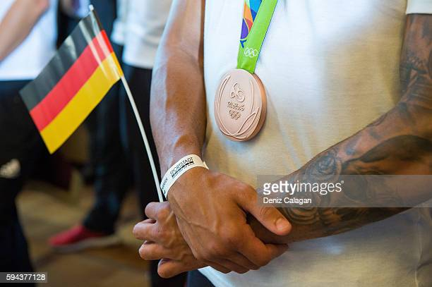 Boxer Artem Harutyunyan poses with his bronze medal on August 23 2016 in Frankfurt am Main Germany
