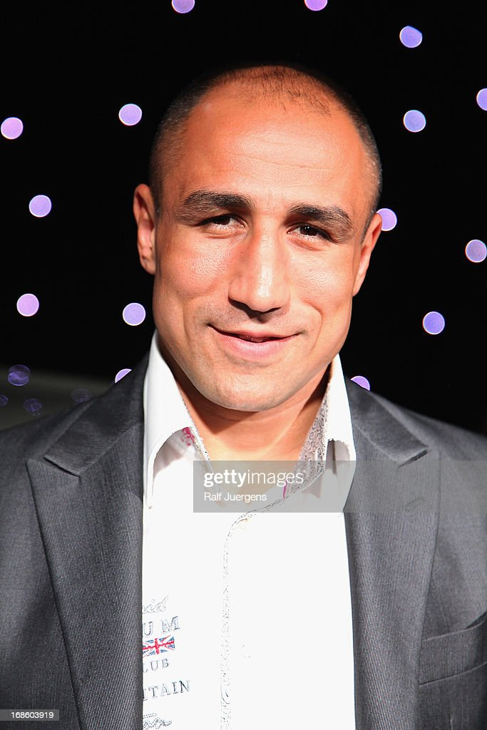 Boxer <a gi-track='captionPersonalityLinkClicked' href=/galleries/search?phrase=Arthur+Abraham&family=editorial&specificpeople=643669 ng-click='$event.stopPropagation()'>Arthur Abraham</a> attends the praesentation of the new Rolls Royce Wraith in German premiere at 'Procar-Automobile' on May 11, 2013 in Cologne, Germany.