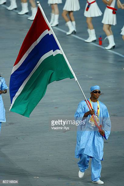 Boxer Badou Jack of Gambia carries his country's flag during the Opening Ceremony for the 2008 Beijing Summer Olympics at the National Stadium on...