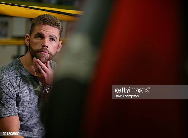 Boxer Billy Joe Saunders gives a television interview during a media workout at Oliver's Gym on December 14 2015 in Salford England Saunders faces...
