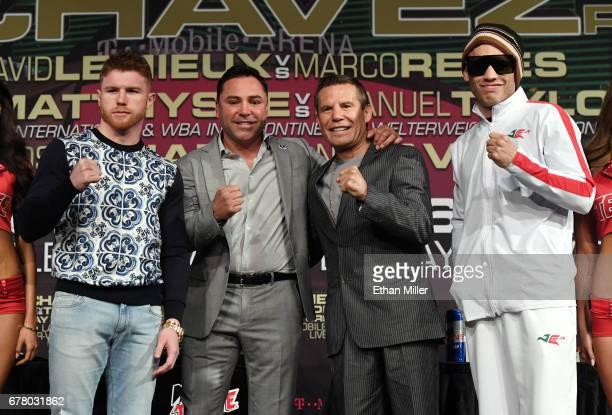 Boxer Canelo Alvarez Chairman and CEO of Golden Boy Promotions Oscar De La Hoya former boxer Julio Cesar Chavez Sr and his son boxer Julio Cesar...