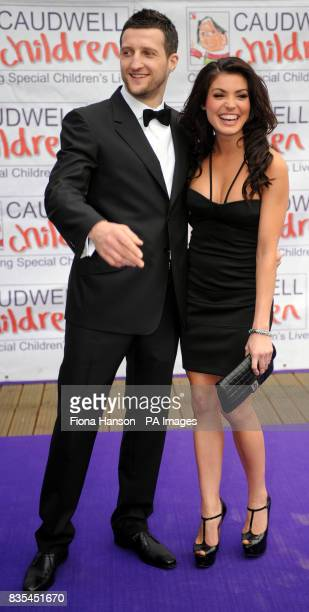 Boxer Carl Froch and companion name not given arrive for the Butterfly Ball in Battersea Park London The event by Caudwell Children aims to raise...