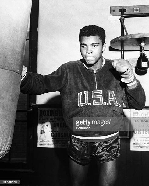 Boxer Cassius Clay trains with a punching bag for the 1960 Olympic Games