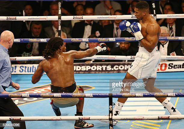 US boxer Charles Martin falls to the canvas after British boxer Anthony Joshua delivered a knock out punch during their IBF World Heavyweight title...
