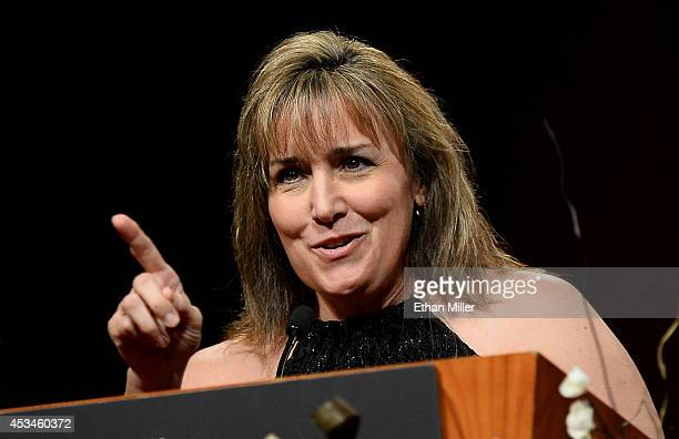 Boxer Christy Martin introduces trainer Miguel Diaz as he is inducted into the Nevada Boxing Hall of Fame at the second annual induction gala at the...
