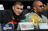 Boxer Daniel Ponce De Leon sits with his WBC featherweight championship belt during the final news conference for his bout against Abner Mares at the...
