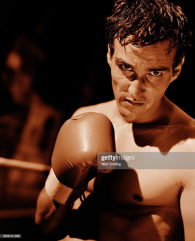 Boxer during fight, close-up (toned B&W) : Stock Photo