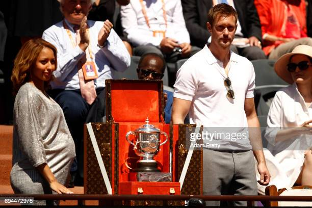 Boxer Estelle Mossely of France and actor Alexander Skarsgard unveil the Suzanne Lenglen Cup prior to the ladies singles final between Jelena...