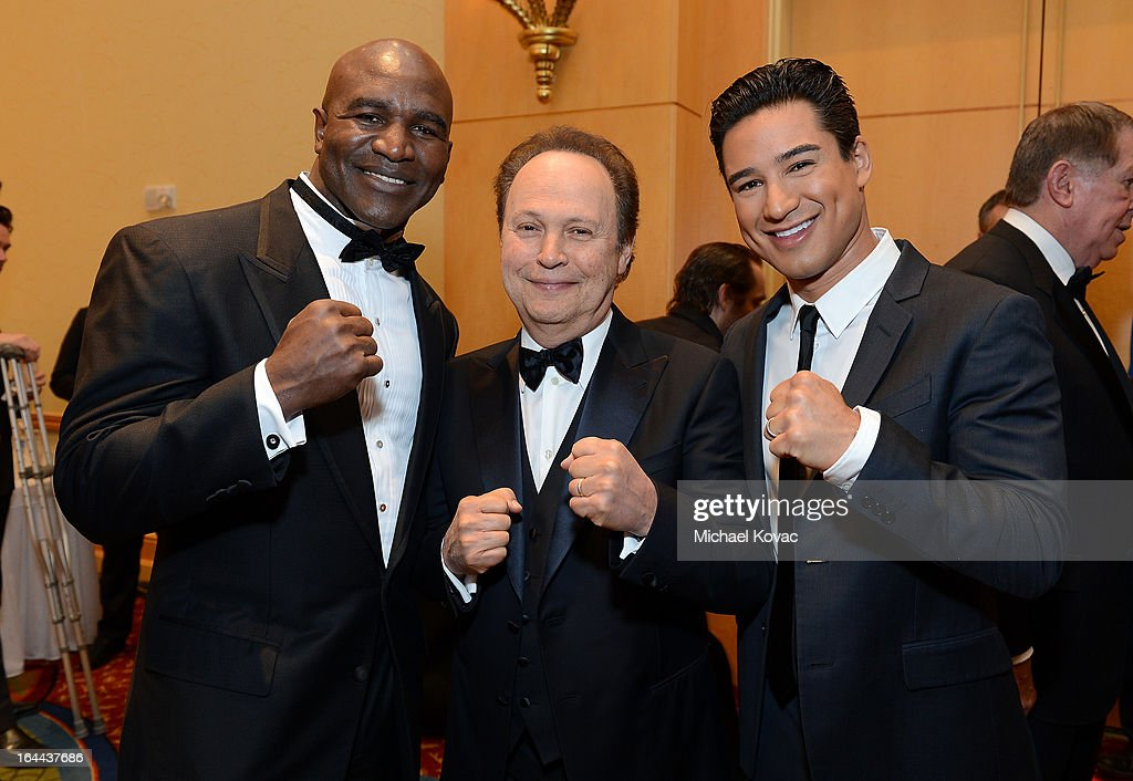 Boxer <a gi-track='captionPersonalityLinkClicked' href=/galleries/search?phrase=Evander+Holyfield&family=editorial&specificpeople=194938 ng-click='$event.stopPropagation()'>Evander Holyfield</a>, Actor <a gi-track='captionPersonalityLinkClicked' href=/galleries/search?phrase=Billy+Crystal&family=editorial&specificpeople=202497 ng-click='$event.stopPropagation()'>Billy Crystal</a>, and TV Personality Mario Lopez with Moet & Chandon at Celebrity Fight Night XIX at JW Marriott Desert Ridge Resort & Spa on March 23, 2013 in Phoenix, Arizona.