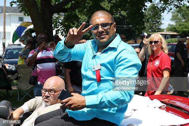 Boxer Fernando Vargas poses while riding in a car during the parade at the International Boxing Hall of Fame induction Weekend of Champions events on...