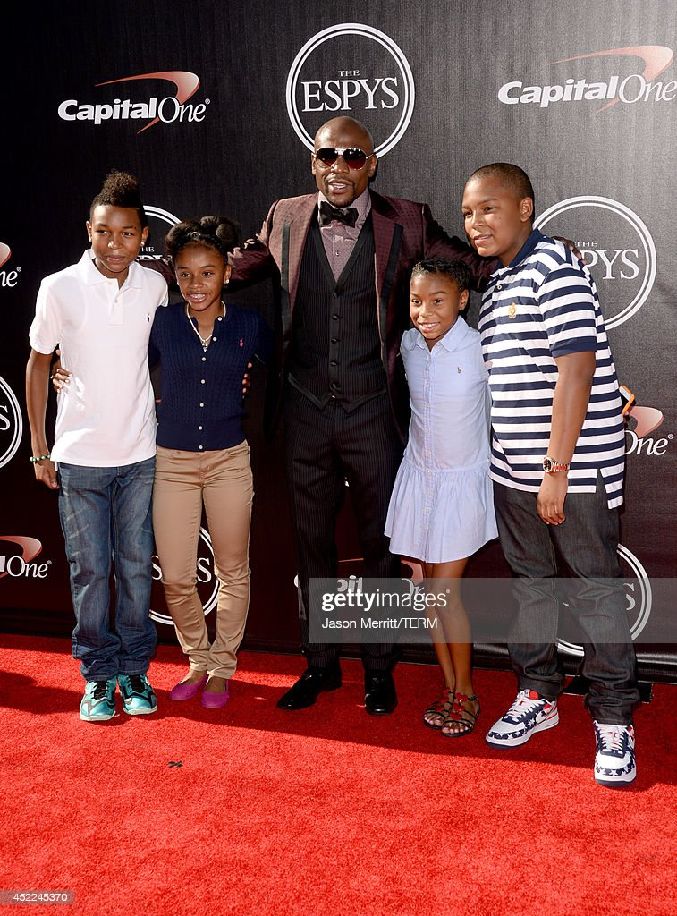Boxer Floyd Mayweather Jr. (C) and guests attend The 2014 ESPYS at Nokia Theatre L.A. Live on July 16, 2014 in Los Angeles, California.