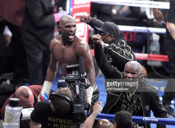 TOPSHOT Boxer Floyd Mayweather Jr and his father Floyd Mayweather Sr celebrate his 10th round TKO victory over mixed martial arts star Conor McGregor...