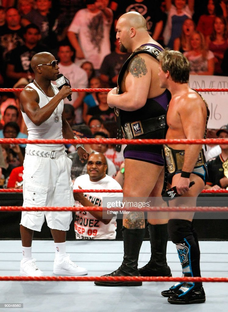 Boxer Floyd Mayweather Jr. appears in the ring with wrestlers Big Show and Chris Jericho during the WWE Monday Night Raw show at the Thomas & Mack Center August 24, 2009 in Las Vegas, Nevada. Mayweather was a special guest host during the broadcast.