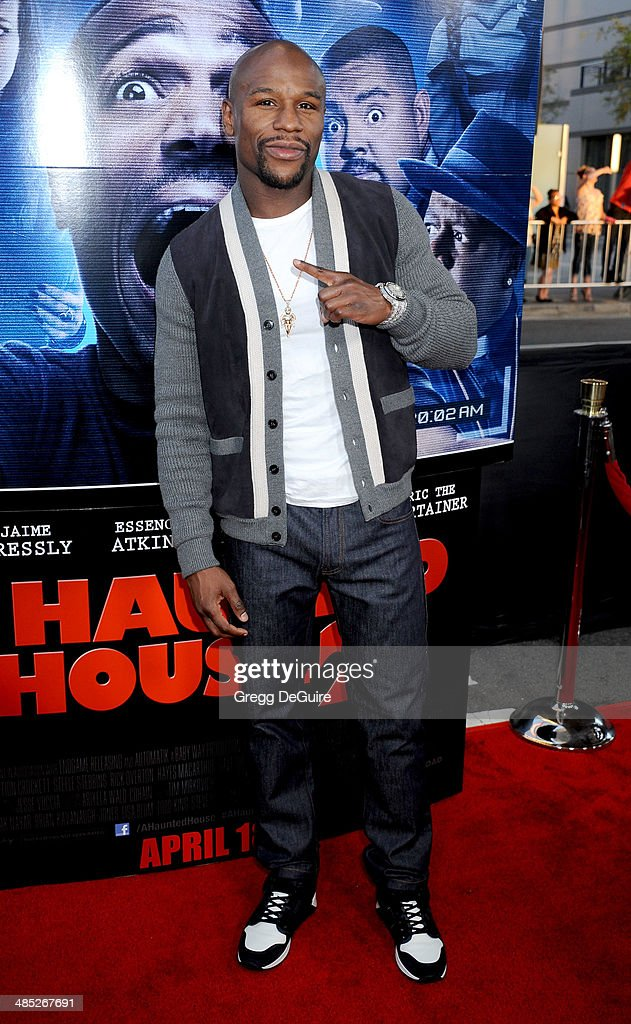 Boxer Floyd Mayweather, Jr. arrives at the Los Angeles premiere of 'A Haunted House 2' at Regal Cinemas L.A. Live on April 16, 2014 in Los Angeles, California.