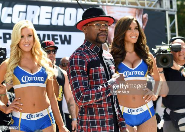 Boxer Floyd Mayweather Jr arrives at Toshiba Plaza on August 22 2017 in Las Vegas Nevada Mayweather will fight UFC lightweight champion Conor...