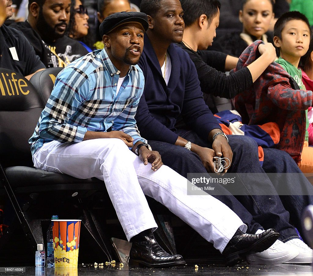Boxer Floyd Mayweather Jr. attends the preseason game between the Los Angeles Lakers and the Sacramento Kings at the MGM Grand Garden Arena on October 10, 2013 in Las Vegas, Nevada.