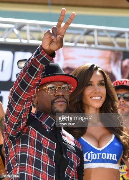 Boxer Floyd Mayweather Jr gestures as he arrives at Toshiba Plaza on August 22 2017 in Las Vegas Nevada Mayweather will fight UFC lightweight...