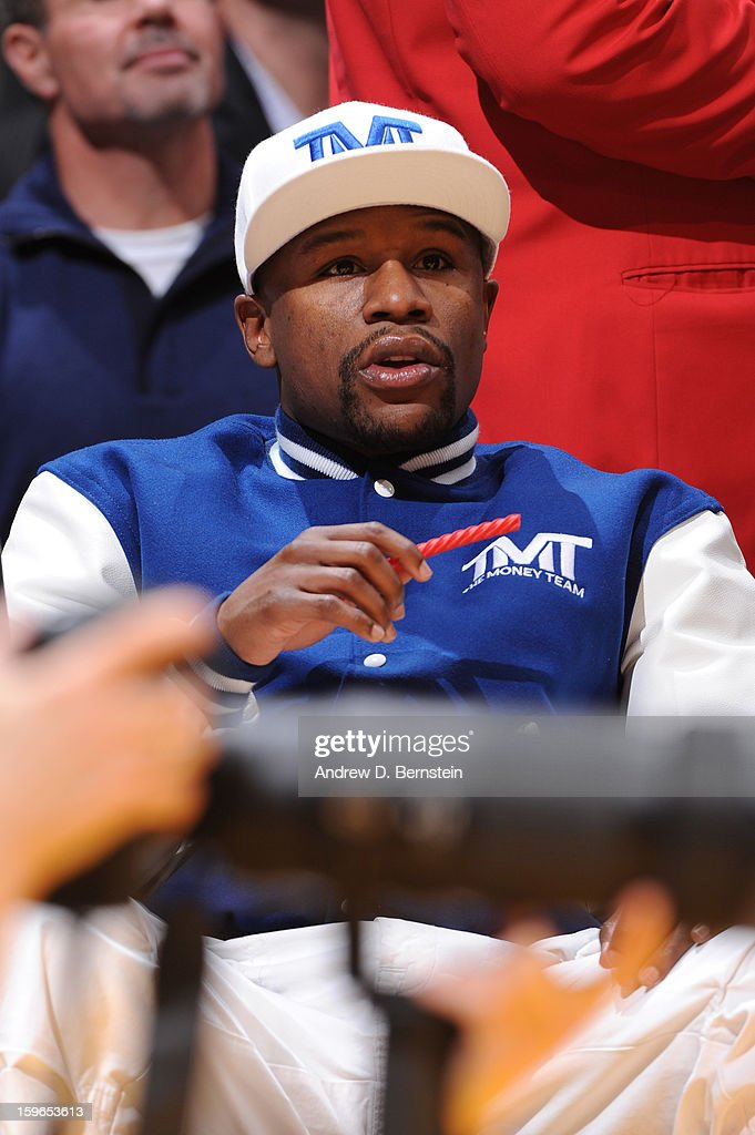 Boxer Floyd Mayweather Jr. looks on during a game between the Miami Heat and the Los Angeles Lakers at Staples Center on January 15, 2013 in Los Angeles, California.