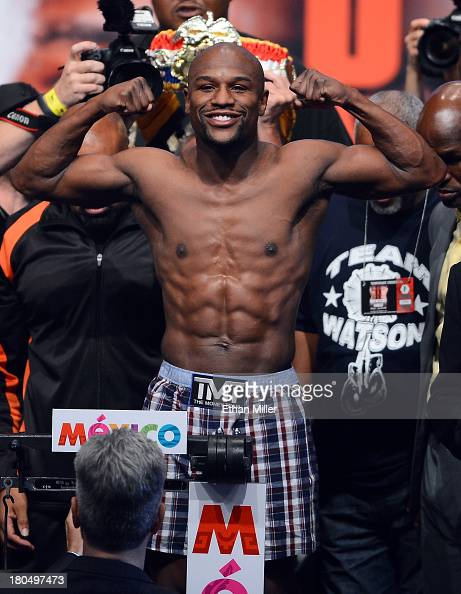 Boxer Floyd Mayweather Jr poses on the scale during the official weighin for his bout against Canelo Alvarez at the MGM Grand Garden Arena on...