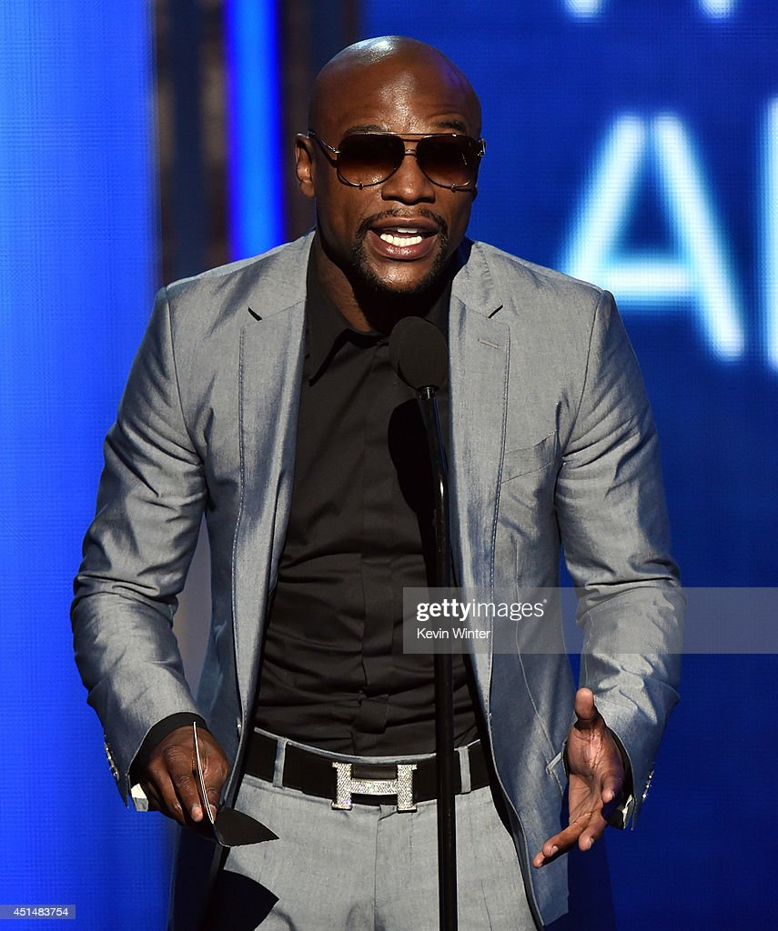 Boxer <a gi-track='captionPersonalityLinkClicked' href=/galleries/search?phrase=Floyd+Mayweather+Jr.&family=editorial&specificpeople=2294114 ng-click='$event.stopPropagation()'>Floyd Mayweather Jr.</a> speaks onstage during the BET AWARDS '14 at Nokia Theatre L.A. LIVE on June 29, 2014 in Los Angeles, California.