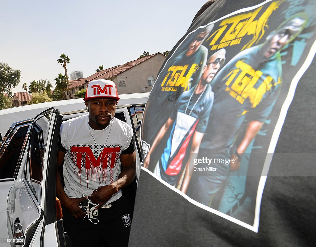 Boxer Floyd Mayweather Jr. steps out of a Rolls Royce as he arrives at the Mayweather Boxing Club to work out on April 22, 2014 in Las Vegas, Nevada. Mayweather will face Marcos Maidana in a 12-round world championship unification bout in Las Vegas on May 3.