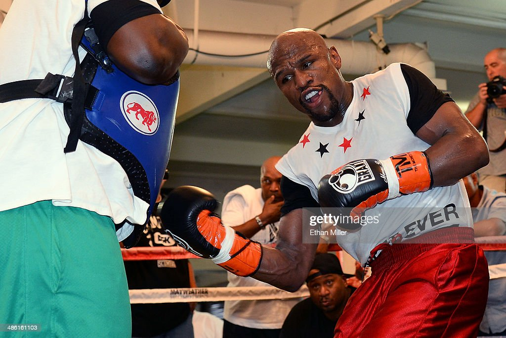 Boxer Floyd Mayweather Jr. works out with his co-trainer Nate Jones at the Mayweather Boxing Club on April 22, 2014 in Las Vegas, Nevada. Mayweather will face Marcos Maidana in a 12-round world championship unification bout in Las Vegas on May 3.