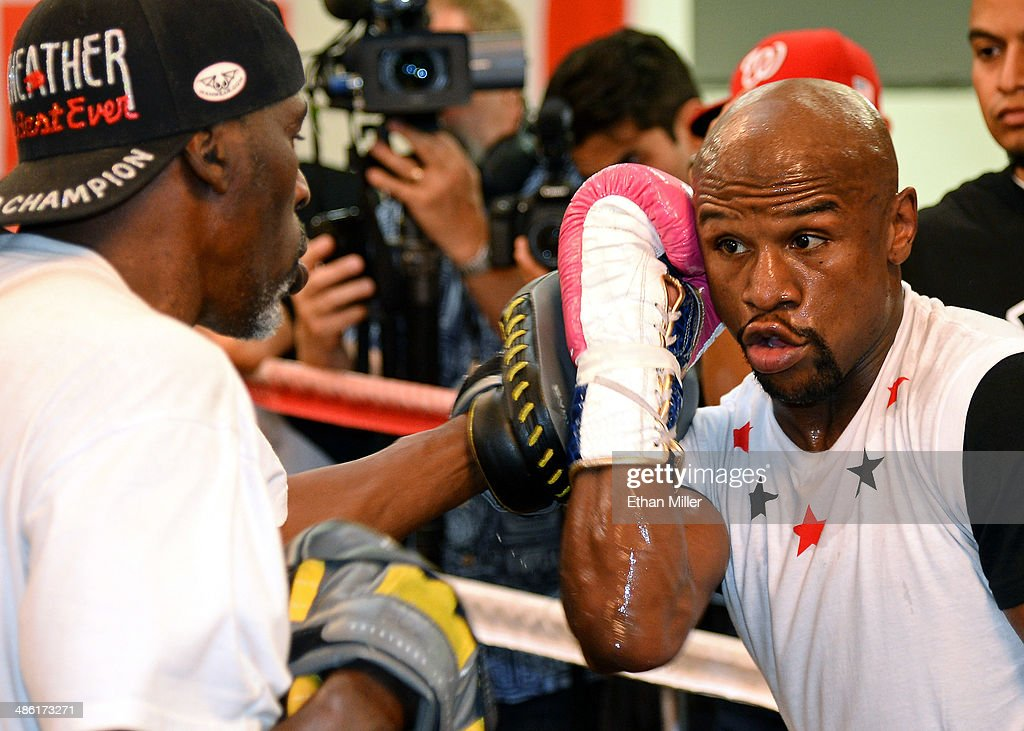 Boxer <a gi-track='captionPersonalityLinkClicked' href=/galleries/search?phrase=Floyd+Mayweather+Jr.&family=editorial&specificpeople=2294114 ng-click='$event.stopPropagation()'>Floyd Mayweather Jr.</a> (R) works out with his trainer and uncle <a gi-track='captionPersonalityLinkClicked' href=/galleries/search?phrase=Roger+Mayweather&family=editorial&specificpeople=696910 ng-click='$event.stopPropagation()'>Roger Mayweather</a> at the Mayweather Boxing Club on April 22, 2014 in Las Vegas, Nevada. Mayweather Jr. will face Marcos Maidana in a 12-round world championship unification bout in Las Vegas on May 3.