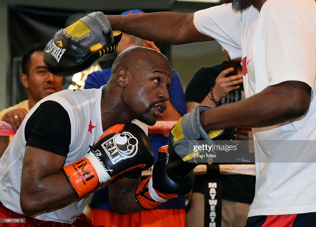 Boxer <a gi-track='captionPersonalityLinkClicked' href=/galleries/search?phrase=Floyd+Mayweather+Jr.&family=editorial&specificpeople=2294114 ng-click='$event.stopPropagation()'>Floyd Mayweather Jr.</a> works out with his trainer and uncle Roger Mayweather at the Mayweather Boxing Club on April 22, 2014 in Las Vegas, Nevada. Mayweather Jr. will face Marcos Maidana in a 12-round world championship unification bout in Las Vegas on May 3.