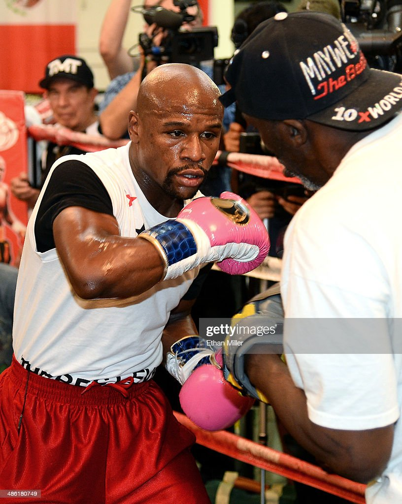 Boxer <a gi-track='captionPersonalityLinkClicked' href=/galleries/search?phrase=Floyd+Mayweather+Jr.&family=editorial&specificpeople=2294114 ng-click='$event.stopPropagation()'>Floyd Mayweather Jr.</a> (L) works out with his trainer and uncle <a gi-track='captionPersonalityLinkClicked' href=/galleries/search?phrase=Roger+Mayweather&family=editorial&specificpeople=696910 ng-click='$event.stopPropagation()'>Roger Mayweather</a> at the Mayweather Boxing Club on April 22, 2014 in Las Vegas, Nevada. Mayweather Jr. will face Marcos Maidana in a 12-round world championship unification bout in Las Vegas on May 3.