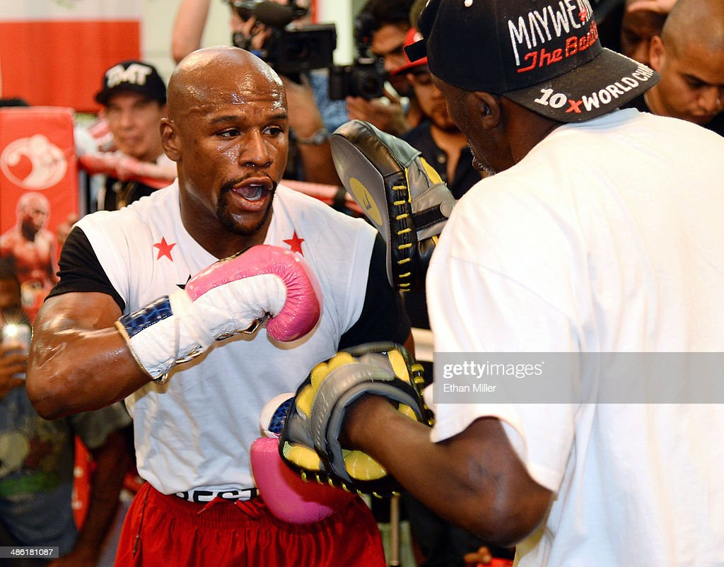 Boxer Floyd Mayweather Jr. (L) works out with his trainer and uncle Roger Mayweather at the Mayweather Boxing Club on April 22, 2014 in Las Vegas, Nevada. Mayweather Jr. will face Marcos Maidana in a 12-round world championship unification bout in Las Vegas on May 3.