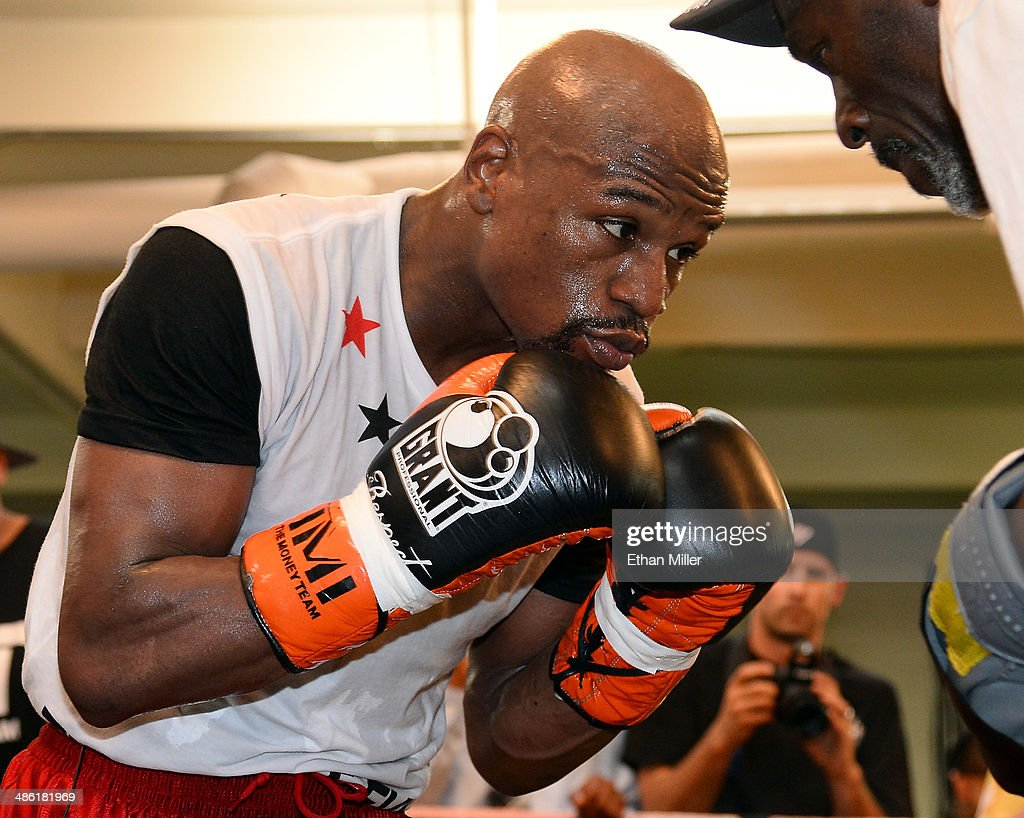 Boxer Floyd Mayweather Jr. works out with his trainer and uncle Roger Mayweather at the Mayweather Boxing Club on April 22, 2014 in Las Vegas, Nevada. Mayweather Jr. will face Marcos Maidana in a 12-round world championship unification bout in Las Vegas on May 3.