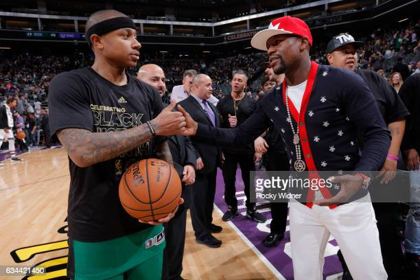 Boxer Floyd Mayweather shakes hands with Isaiah Thomas of the Boston Celtics before the game against the Sacramento Kings at Golden 1 Center on...