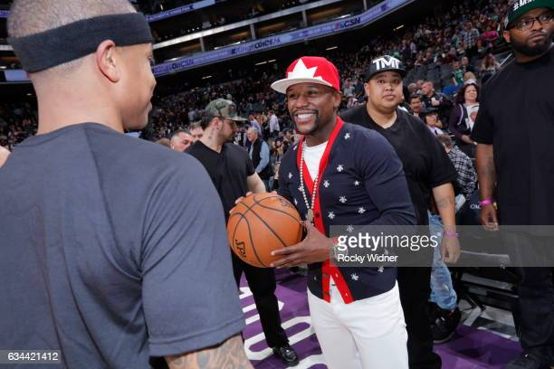 Boxer Floyd Mayweather talks to Isaiah Thomas of the Boston Celtics before the game against the Sacramento Kings at Golden 1 Center on February 8...